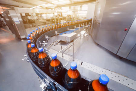 Brewery conveyor line. Automatic beer filling line. Bottles on the conveyor