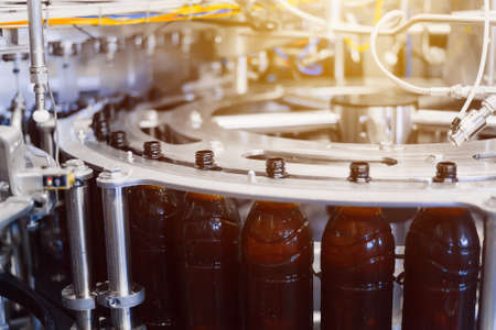 Beer filling line close-up. Beer filling process in an automatic line