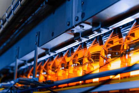 Close up of plastic bottles on a conveyor belt. Industrial production of beer. Automatic filling line Banco de Imagens