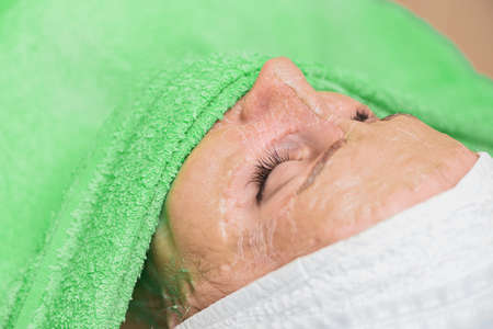 The process of softening the enzyme mask with a wet towel.
