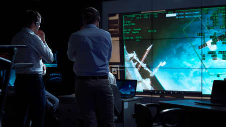 A group of people are controlling the orbiting international space station