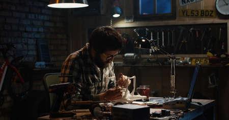 Shot of a man repairing a drone in a workshop Standard-Bild