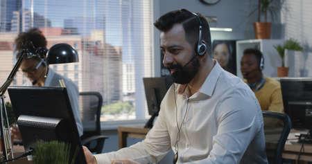 Medium shot of man working at a call center Reklamní fotografie