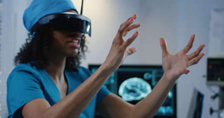 Medium shot of Doctor using VR headset during discussing diagnosis