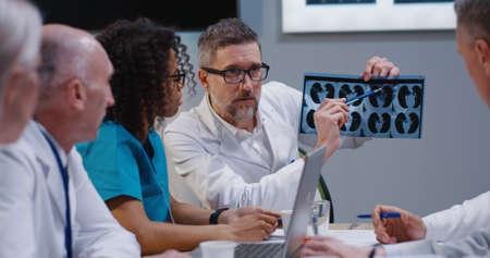 Medium shot of doctors analyzing MRI scan results