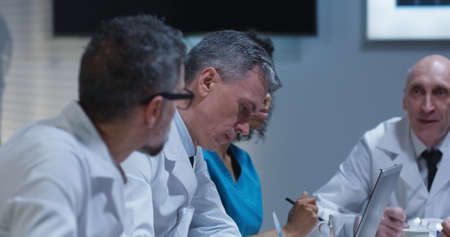 Medium close-up of doctors talking during a meeting 写真素材