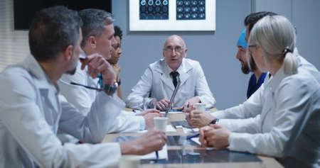 Medium shot of doctors talking during a meeting 写真素材