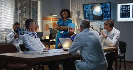 Medium shot of a doctors talking during a meeting 写真素材