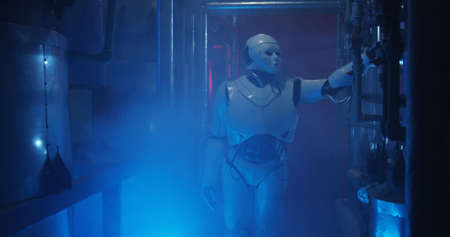 Full shot of a humanoid robot standing in a dim and hazy laboratory