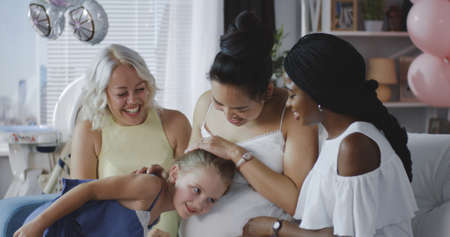 Medium shot of friends celebrating young mother
