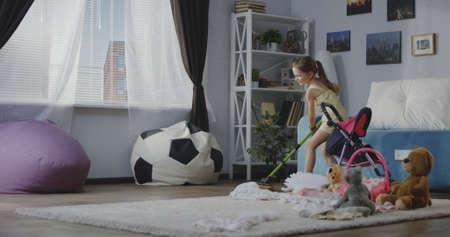 Full shot of girl cleaning floor with sponge mop