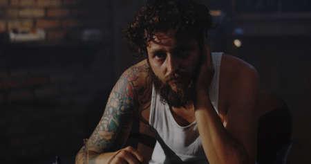 Close-up of a depressed drug addict looking at camera Stock fotó