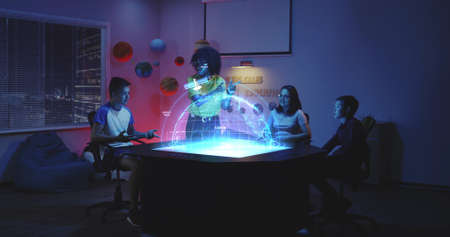 Full shot of a female teacher using a planet Earth hologram while explaining to student in class