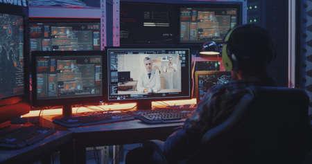 Medium close-up of a hacker intercepting a video call between two doctors
