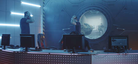Full shot of a gaming team jumping around before sitting down at their computers at a gaming tournament Reklamní fotografie