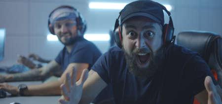 Medium close-up of a gaming team winning a match at a tournament