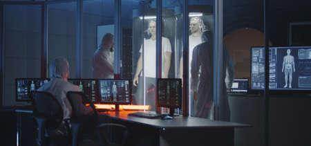 Medium shot of scientists studying human biology in a Martian laboratory with two young male subjects in stasis pods