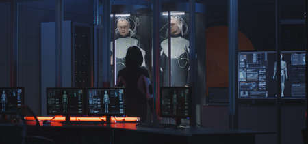Medium shot of a female scientist studying human biology in a Martian laboratory with two young male subjects
