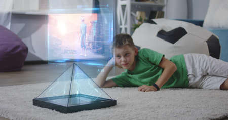 Medium long shot of child watching cartoon on holographic screen