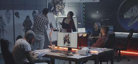 Medium shot of a video game developer team brainstorming Imagens