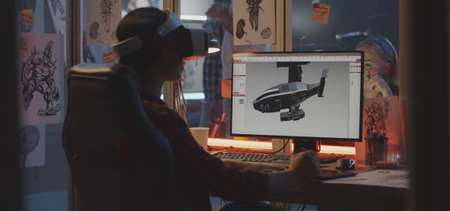 Medium shot of a VR headset wearing young woman modeling an airplane on computer