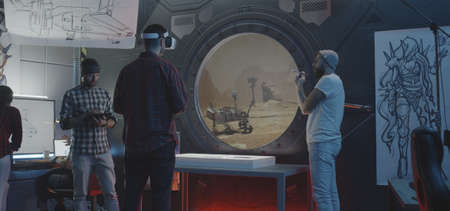 Medium shot of developers testing Mars rover control in a VR video game Stock Photo