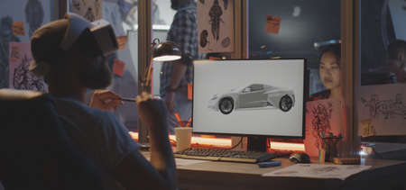 Medium shot of a VR headset wearing man modeling a sports car on computer