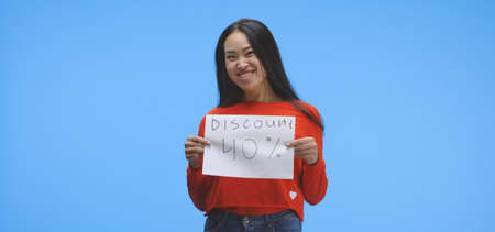 Medium shot of a young woman holding a special offer price sign with forty percent discount