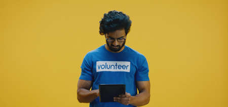 Medium shot of young volunteer with clipboard