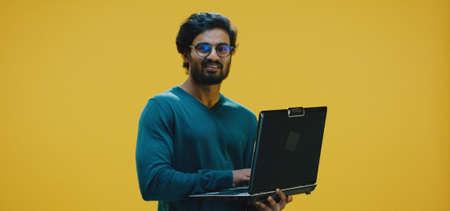 Medium shot of young man typing on his laptop Banco de Imagens - 137938510