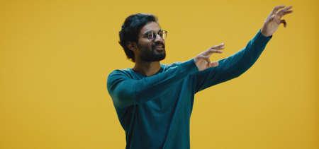 Medium shot of young man dancing Banco de Imagens