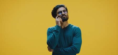 Medium shot of young man thinking Banco de Imagens