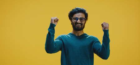 Medium shot of young man cheering Banco de Imagens