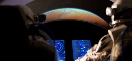Medium shot of two astronauts approaching Mars with a spaceship Stock fotó
