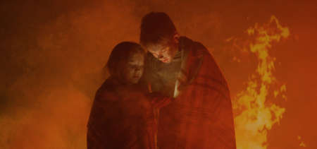 Medium shot of a boy and a girl trapped in fire crying for help and coughing Stock fotó