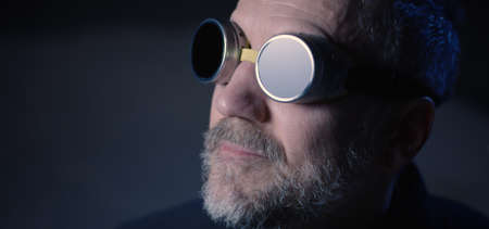 Close-up of of a safety goggles wearing man looking up