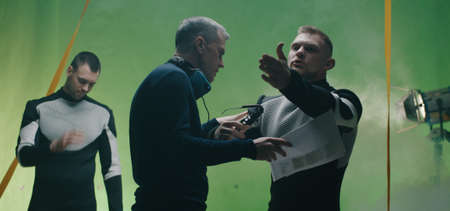 Medium shot of a hot-tempered actor quarreling with the director