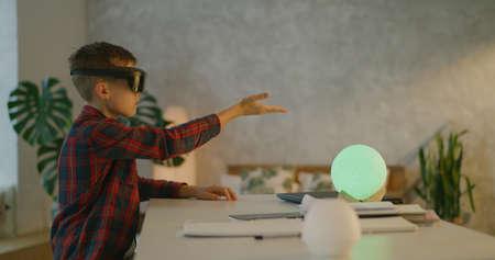 Medium shot of a boy using VR technology at home