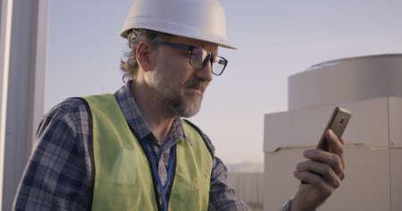 Medium close-up of an engineer having a video call Banco de Imagens
