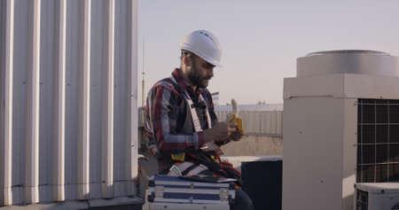 Medium close-up of an engineer eating a banana during his break