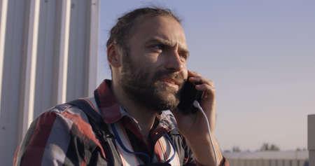 Medium close-up of an engineer having a phone call