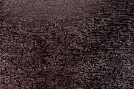 Texture of crumpled dark brown imitation leather. Standard-Bild