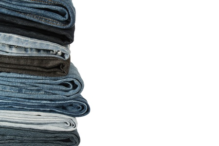 seam: A pile of jeans on a white background Stock Photo