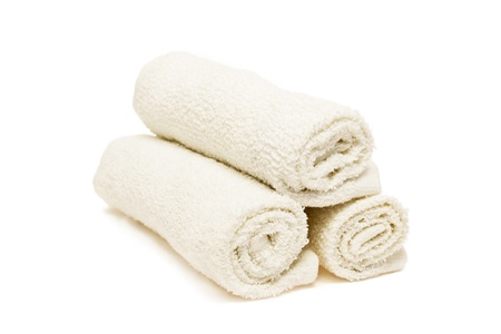 absorb:   Three white soft towels on white background   Stock Photo