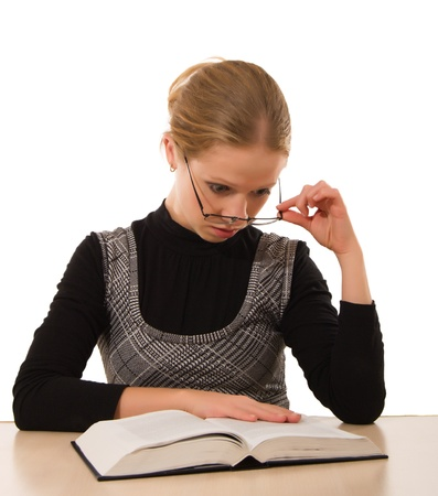 Strict girl reading a book on a white background photo