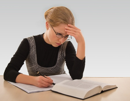 young girl is preparing for the exam photo