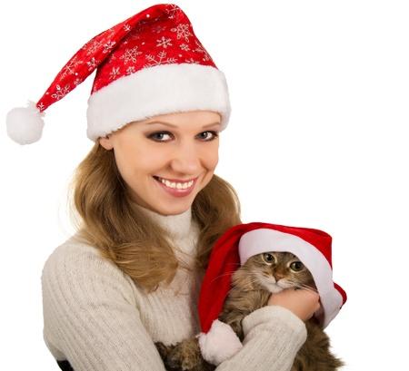 Beautiful mrs. Santa with lovely  kitten photo
