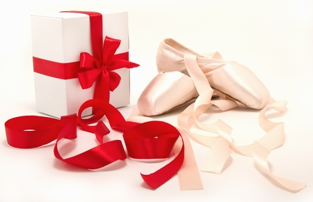 ballet shoes: ballet shoes and a Ballet shoes and a gift with red ribbons Stock Photo