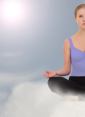 meditates: Yoga woman meditates in the sky and clouds