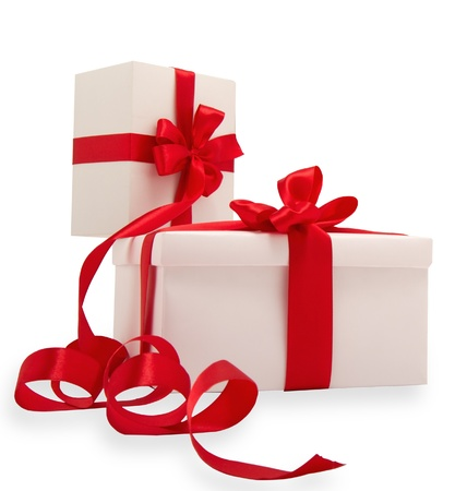 boxed: Two white gifts with red ribbons on a white background